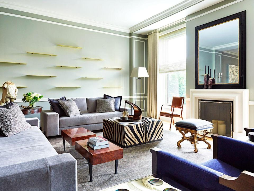 <p>Create a gallery wall with more depth by laying out a pattern with floating shelves instead of hanging framed artwork. In this living room designed by Alberto Villalobos, the offset composition and metallic material is enough of a statement, but you could also fill yours with decor and books to fill more of the negative space. </p>