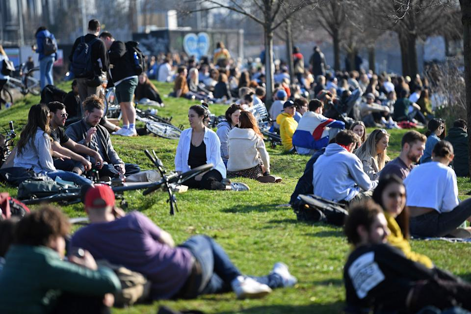 People gather in Hackney Wick to bask in the sunAFP via Getty Images