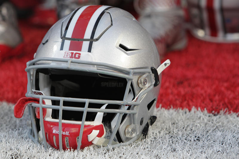 An Ohio State football helmet on the field after their NCAA college football game against Northern Illinois during an NCAA college football game Saturday, Sept. 19, 2015, in Columbus, Ohio. (AP Photo/Jay LaPrete)
