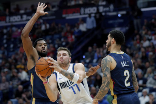 Doncic's triple-double lifts Mavericks over Pelicans 123-116