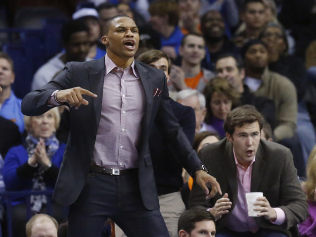 Oklahoma City Thunder guard Russell Westbrook cheers from the bench in the first quarter of an NBA basketball game against the Portland Trail Blazers in Oklahoma City, Tuesday, Jan. 21, 2014. (AP Photo/Sue Ogrocki)