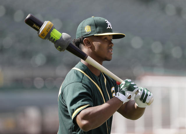 If Kyler Murray doesn't declare for the NFL draft, he's expected to report to the A's in February. (AP)