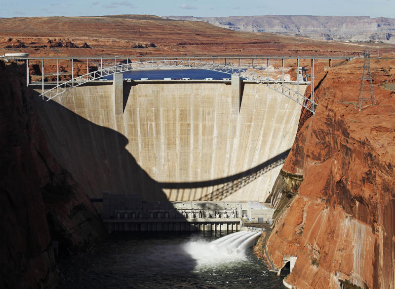 FILE - This Nov. 19, 2012 file photo shows the high-flow release of water into the Colorado River from bypass tubes at Glen Canyon Dam in Page, Ariz. An advocacy group is calling the Colorado River the nation's most endangered waterway. An annual American Rivers report being released Wednesday April 17, 2013, doesn't call pollution the problem. It instead cites drought and demand.  (AP Photo/The Arizona Republic, Rob Schumacher, file)  MARICOPA COUNTY OUT; MAGS OUT; NO SALES