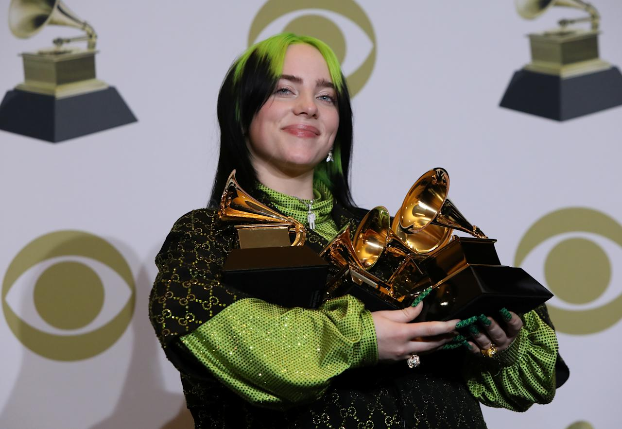 "62nd Grammy Awards – Photo Room– Los Angeles, California, U.S., January 26, 2020 – Billie Eilish poses backstage with her awards to include Song of the Year for ""Bad Guy"" , Best New Artist, and Album of the Year for  ""When We All Fall Asleep, Where Do We Go?"". REUTERS/Monica Almeida     TPX IMAGES OF THE DAY"