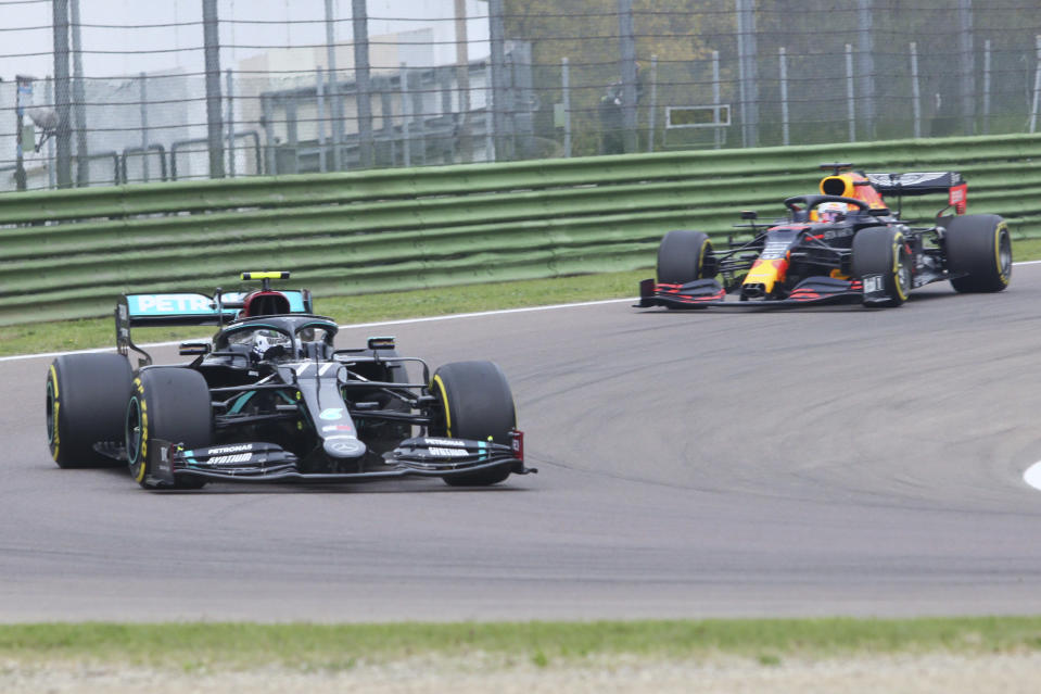Mercedes driver Valtteri Bottas of Finland leads Red Bull driver Max Verstappen of the Netherlands at the start of the Emilia Romagna Formula One Grand Prix, at the Enzo and Dino Ferrari racetrack, in Imola, Italy, Sunday, Nov. 1, 2020. (Davide Gennari/Pool Photo)