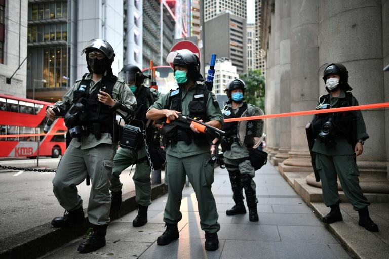 Riot police officers stand guard ahead of a pro-democracy march in Hong Kong a year after pro-democracy protests erupted following opposition to a bill allowing extraditions to mainland China (AFP Photo/Anthony WALLACE)