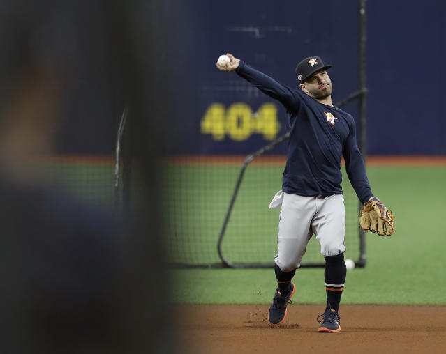 Houston Astros second baseman Jose Altuve throws the ball during practice Sunday, Oct. 6, 2019, in St. Petersburg, Fla. The Astros take on the Tampa Bay Rays in Game 3 of a baseball American League Division Series on Monday. (AP Photo/Chris O'Meara)