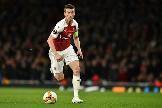 Arsenal captain Laurent Koscielny has refused to travel on the club's pre-season tour of the United States (AFP Photo/Glyn KIRK )