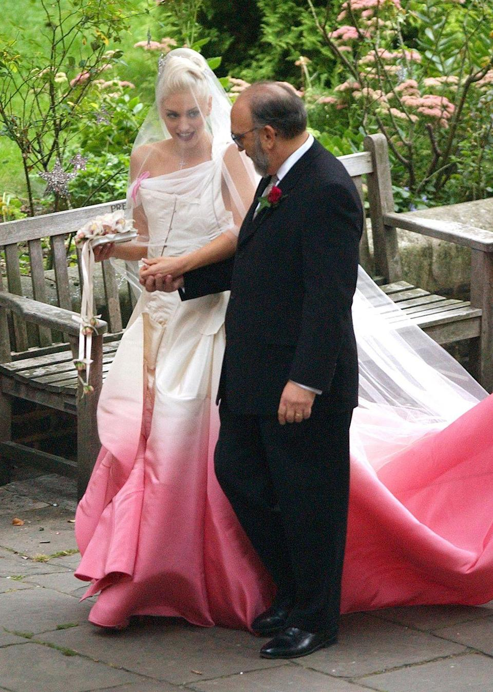 <p>One of the most famous celeb colourful wedding dresses has to be Gwen Stefani's mesmerising bright pink dip-dyed dress worn back in 2002 for her wedding to Gavin Rossdale.</p>