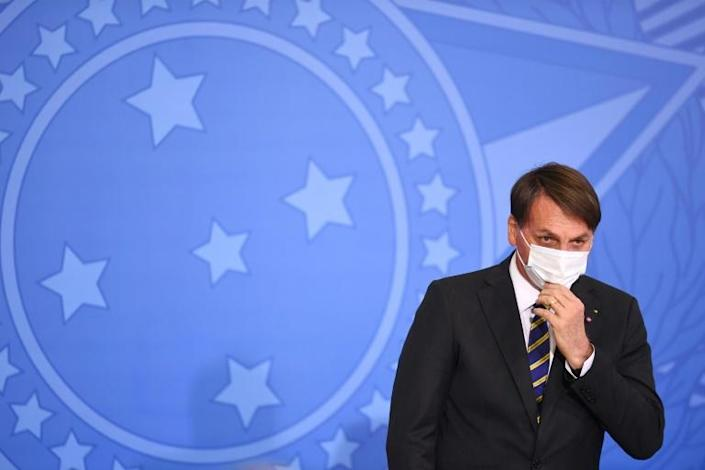 President Jair Bolsonaro has continued to downplay the severity of the COVID-19 pandemic even after contracting the virus himself (AFP Photo/EVARISTO SA)