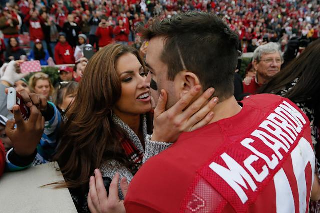 TUSCALOOSA, AL - NOVEMBER 23: AJ McCarron #10 of the Alabama Crimson Tide celebrates their 49-0 win over the Chattanooga Mocs with his girlfriend Katherine Webb at Bryant-Denny Stadium on November 23, 2013 in Tuscaloosa, Alabama. (Photo by Kevin C. Cox/Getty Images)