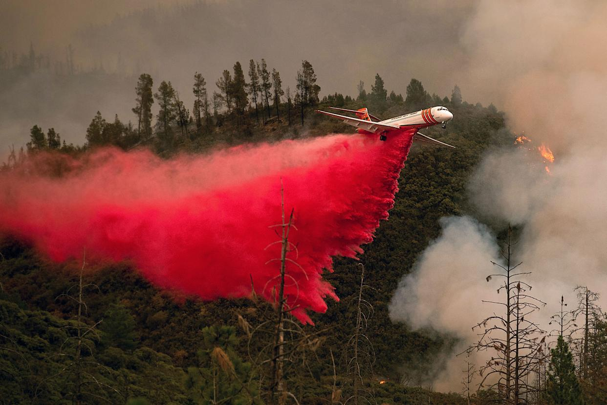 An air tanker drops retardant while battling the Ferguson fire in Stanislaus National Forest, near Yosemite National Park, California on July 21, 2018.