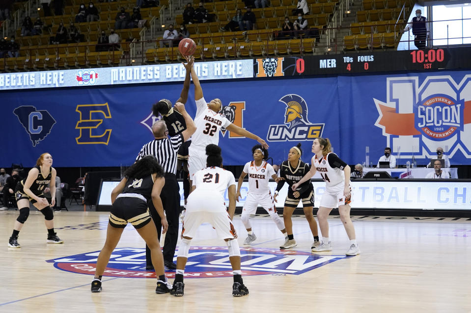 Wofford forward Jamari McDavid (12) and Mercer forward Jaron Dougherty (32) tip off for the start of the NCAA women's college basketball championship game for the Southern Conference tournament, Sunday, March 7, 2021, in Asheville, N.C. (AP Photo/Kathy Kmonicek)