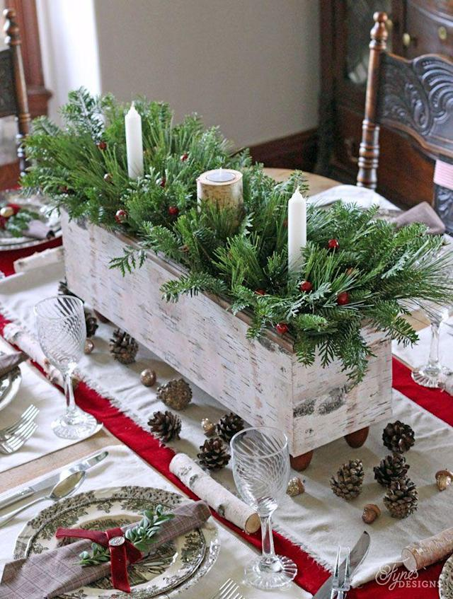 """<p>A handmade wood box not only creates a focal point in a dining room, but can also be easily used throughout the rest of the year as table decor. </p><p><strong>Get the tutorial at <a href=""""http://www.fynesdesigns.com/christmas-table-centrepiece-one-item-challenge/"""" rel=""""nofollow noopener"""" target=""""_blank"""" data-ylk=""""slk:Fynes Designs"""" class=""""link rapid-noclick-resp"""">Fynes Designs</a>.</strong></p><p><strong><a href=""""https://www.amazon.com/Planter-Rectangle-Woodland-Decor-Centerpiece/dp/B01N0645B4"""" rel=""""nofollow noopener"""" target=""""_blank"""" data-ylk=""""slk:SHOP PLANTER BOXES"""" class=""""link rapid-noclick-resp"""">SHOP PLANTER BOXES</a></strong></p>"""