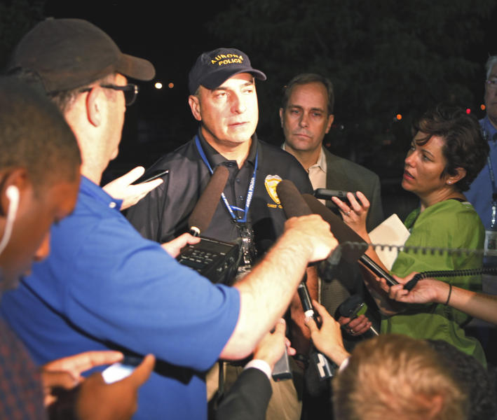 Aurora Police Chief Daniel Oates talks to media at Aurora Mall where as many as 14 people were killed and many injured at a shooting at the Century 16 movie theatre in Aurora, Colo., Friday, July 20, 2012. (AP Photo/Ed Andrieski)