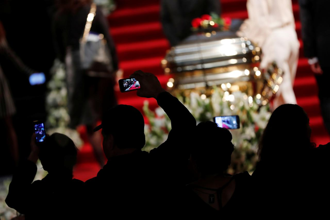 Fans take pictures of the coffin as they pay tribute to late Mexican singing legend Jose Jose at Bellas Artes Palace in Mexico City, Mexico October 9, 2019. REUTERS/Carlos Jasso