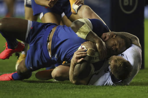 France's Virimi Vakatawa scores a try despite the tackle of Scotland's Stuart Hogg during the Autumn Nations Cup rugby union international match between Scotland and France at the Murrayfield stadium in Edinburgh, Scotland, Sunday, Nov. 22, 2020. (AP Photo/Scott Heppell)
