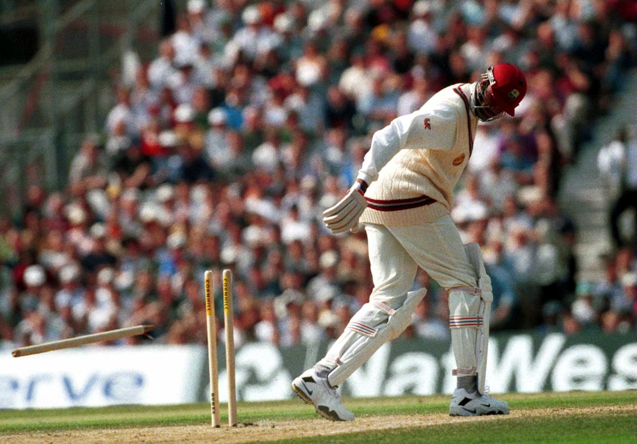 2 Sep 2000:  Courtney Walsh of the West Indies looks round to see his stump fly through the air as he is clean bowled by Craig White of England during the Fifth Cornhill Insurance Test between England and the West Indies at the Oval, London.  Mandatory Credit: Laurence Griffiths/ALLSPORT