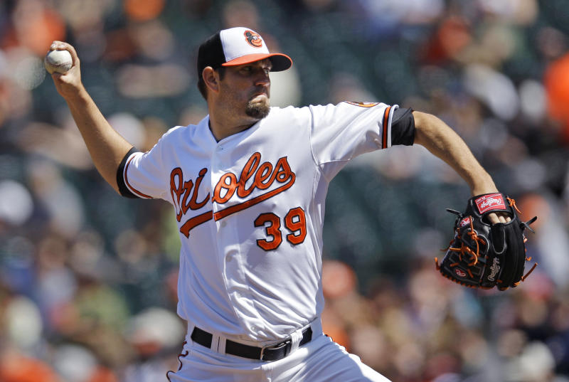 Baltimore Orioles starting pitcher Jason Hammel throws to the Minnesota Twins in the fourth inning of a baseball game in Baltimore, Sunday, April 8, 2012. (AP Photo/Patrick Semansky)