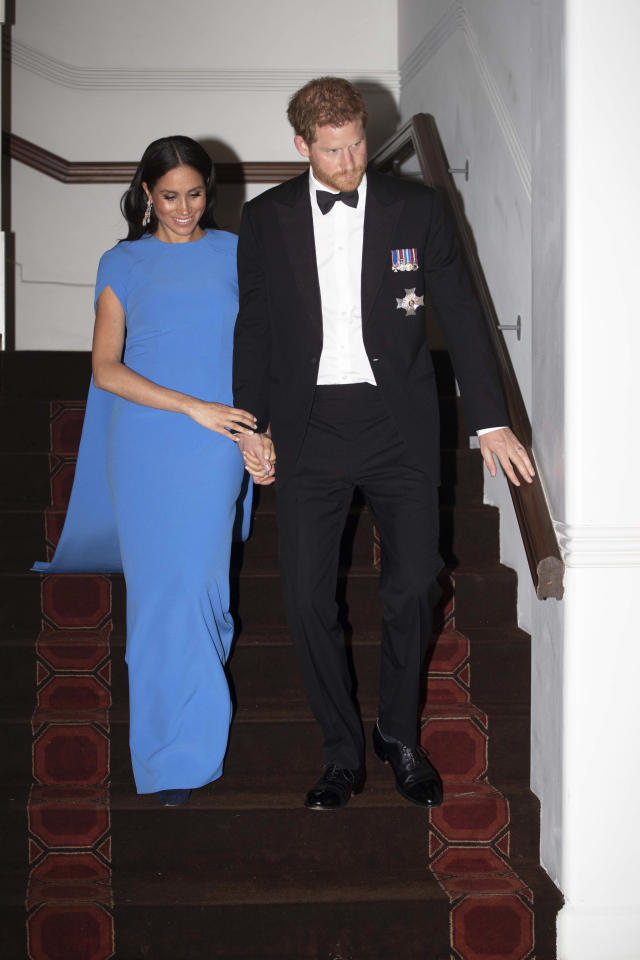 """The Duchess of Sussex stuck to her go-to hue on day seven of the couple's royal tour in a £1,095 dress by <a href=""""https://www.safiyaa.com/collections/dresses/products/ginkgo-cape-dress"""" rel=""""nofollow noopener"""" target=""""_blank"""" data-ylk=""""slk:Safiyaa"""" class=""""link rapid-noclick-resp"""">Safiyaa</a>. <em>[Photo: Getty]</em>"""