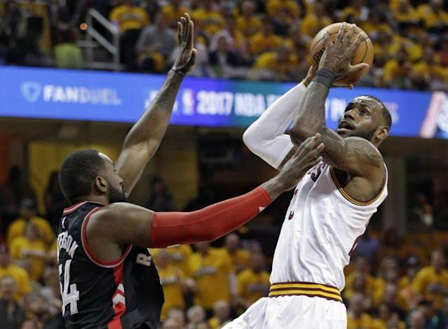 "<a class=""link rapid-noclick-resp"" href=""/nba/teams/cle/"" data-ylk=""slk:Cleveland Cavaliers"">Cleveland Cavaliers</a>' LeBron James, right, drives to the basket against <a class=""link rapid-noclick-resp"" href=""/nba/teams/tor/"" data-ylk=""slk:Toronto Raptors"">Toronto Raptors</a>' <a class=""link rapid-noclick-resp"" href=""/nba/players/4729/"" data-ylk=""slk:Patrick Patterson"">Patrick Patterson</a> (54) in the first half in Game 1 of a second-round NBA basketball playoff series,, Monday, May 1, 2017, in Cleveland. (AP Photo/Tony Dejak)"