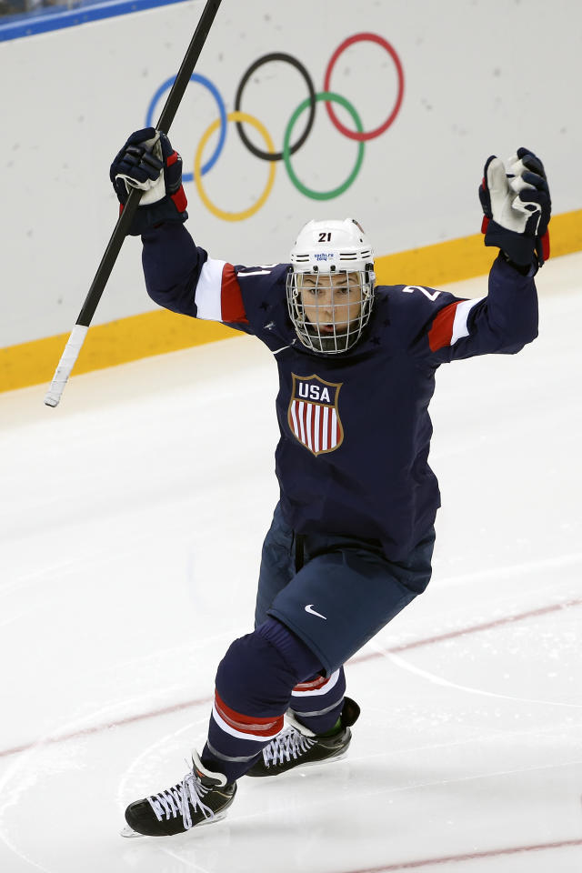Hilary Knight of the Untied States celebrates her goal during the first period of the women's ice hockey game against Finland at the Shayba Arena during the 2014 Winter Olympics, Saturday, Feb. 8, 2014, in Sochi, Russia. (AP Photo/Petr David Josek)