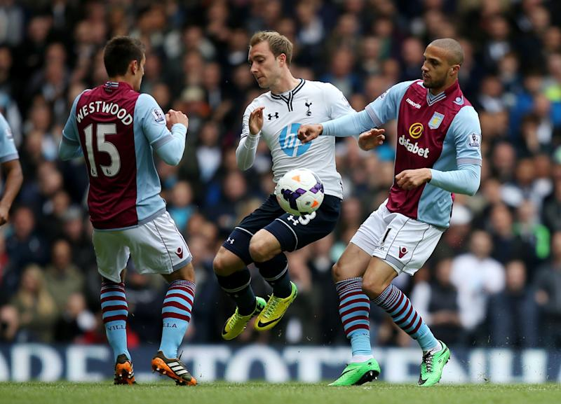Tottenham Hotspur's Christian Eriksen, center, battles for the ball with Aston Villa's Jordan Bowery, right, and Ashley Westwood during the English Premier League soccer match at White Hart Lane, London, Sunday May 11, 2014. (AP Photo/PA, John Walton) UNITED KINGDOM OUT NO SALES NO ARCHIVE