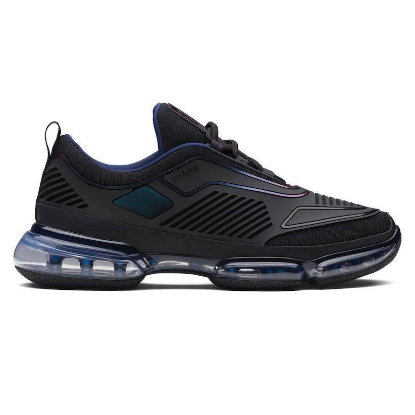 """<p><strong>Cloudbust Air Sneakers</strong></p><p>prada.com</p><p><strong>$1050.00</strong></p><p><a href=""""https://www.prada.com/us/en/men/shoes/sneakers/products.prada_cloudbust_sneakers_air_sneakers.2EG298_2OGB_F0002.html"""" rel=""""nofollow noopener"""" target=""""_blank"""" data-ylk=""""slk:Shop Now"""" class=""""link rapid-noclick-resp"""">Shop Now</a></p><p>Prada's sneakers are split between an impulse towards total minimalism (think: low-profile tonal white plimsolls) and the highly technical, from construction right down to the look of the things. But either one you go for looks truly purposeful, which makes them an interesting shoe to incorporate regardless of what floats your boat aesthetically. </p>"""