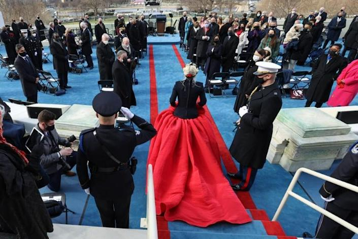 "US singer Lady Gaga (C) arrives to perform ""The Star-Spangled Banner"" during the 59th Presidential Inauguration on January 20, 2021, at the US Capitol in Washington, DC"