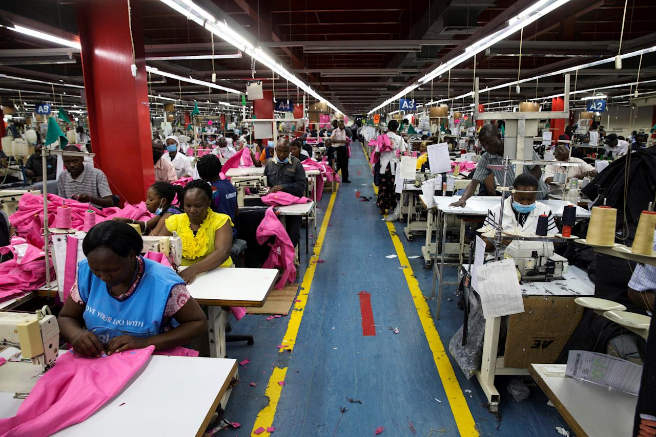 FILE PHOTO: Employees work on the manufacturing line at the United Aryan Export Processing Zone textile factory in Nairobi, Kenya April 13, 2017. REUTERS/Baz Ratner/File Photo