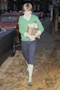 <p>Do our eyes deceive us, or is Diana wearing lime green tights to match her preppy V-neck jumper? It really looks like it, and we're loving such an edgy style move from the soon-to-be-royal, who completed the look with a woven basket and checked skirt. </p>