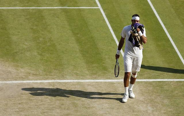 Argentina's Juan Martin Del Potro wipes his face in his match against Serbia's Novak Djokovic during day eleven of the Wimbledon Championships at The All England Lawn Tennis and Croquet Club, Wimbledon.