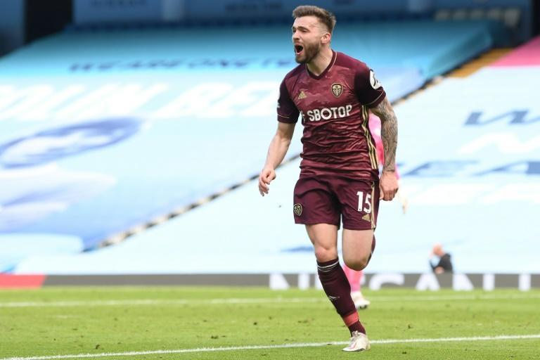 Man City shocked: Stuart Dallas scored twice to give 10-man Leeds a 2-1 win at the Etihad on Saturday