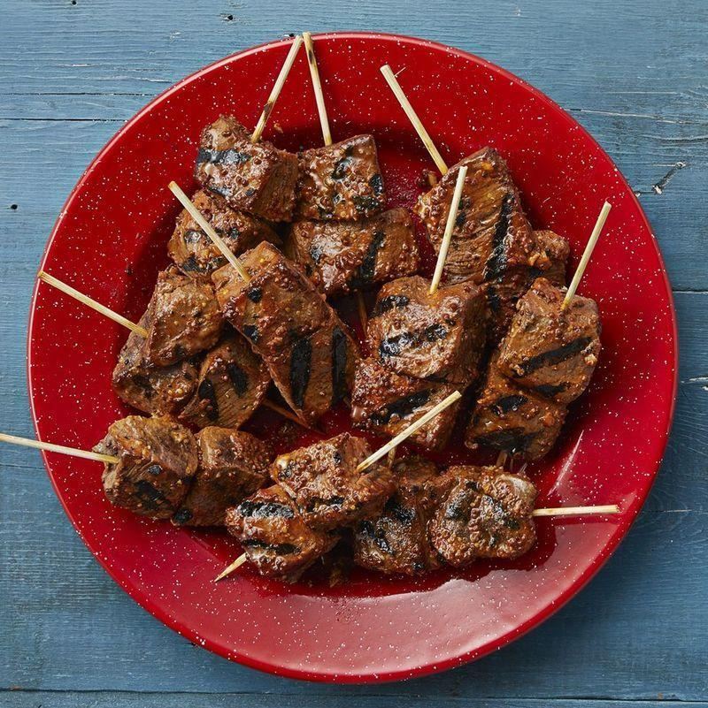 """<p>These grilled beef skewers are a perfect option for a cocktail party or tailgate-style gathering. They're incredibly filling—but the portions are perfectly petite.</p><p><strong><a href=""""https://www.thepioneerwoman.com/food-cooking/recipes/a34590635/bobby-flay-garlic-mustard-grilled-beef-skewers/"""" rel=""""nofollow noopener"""" target=""""_blank"""" data-ylk=""""slk:Get the recipe"""" class=""""link rapid-noclick-resp"""">Get the recipe</a>.</strong></p><p><a class=""""link rapid-noclick-resp"""" href=""""https://go.redirectingat.com?id=74968X1596630&url=https%3A%2F%2Fwww.walmart.com%2Fsearch%2F%3Fquery%3Dgrill%2Btools&sref=https%3A%2F%2Fwww.thepioneerwoman.com%2Ffood-cooking%2Fmeals-menus%2Fg36004463%2Fmemorial-day-appetizers%2F"""" rel=""""nofollow noopener"""" target=""""_blank"""" data-ylk=""""slk:SHOP GRILL TOOLS"""">SHOP GRILL TOOLS</a></p>"""