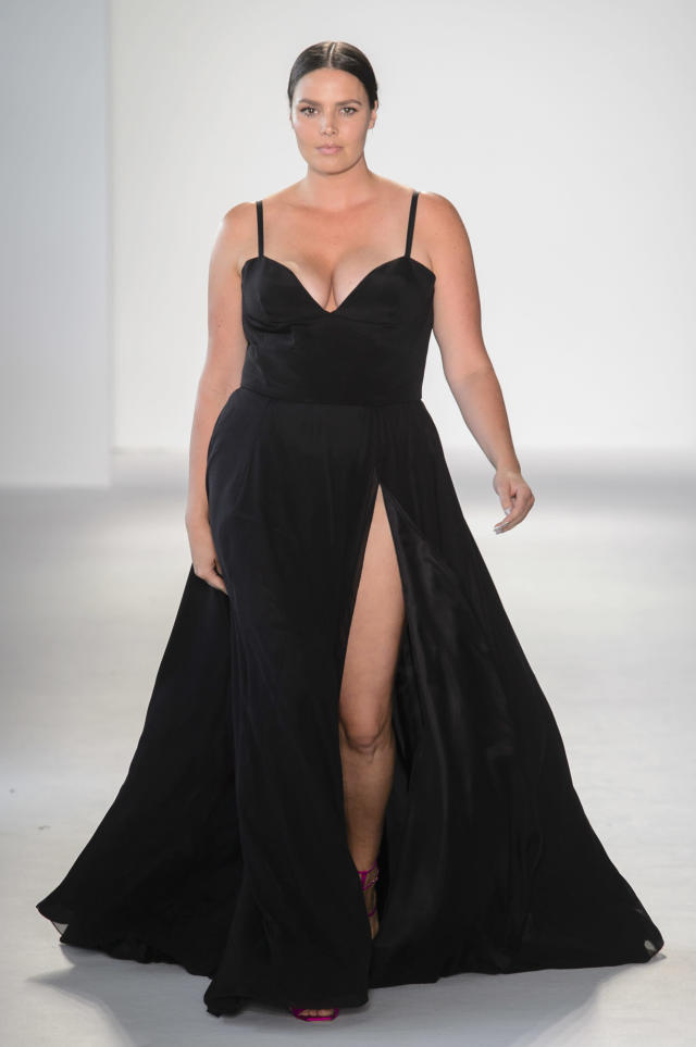 <p><i>Model Candice Huffine wears a black high-slit dress from the SS18 Christian Siriano collection. (Photo: ImaxTree) </i></p>