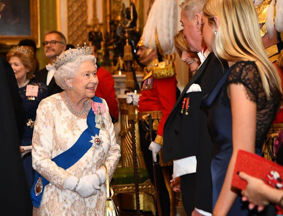 <p>The Queen looked delighted to meet attendees at the reception.</p>