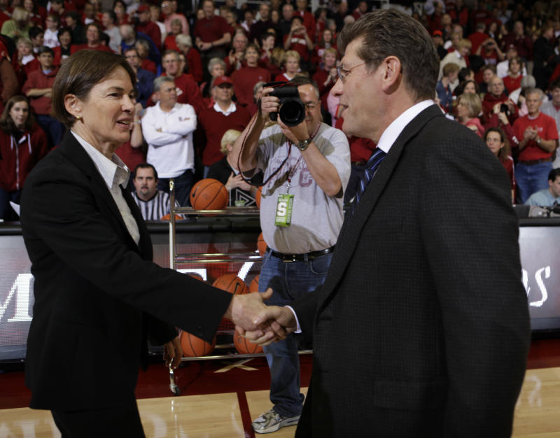 Stanford coach Tara VanDerveer, left, shakes hands with Connecticut coach Geno Auriemma before an NCAA college basketball game in Stanford, Calif., Thursday, Dec. 30, 2010. Stanford upset Connecticut 71-59. (AP Photo/Paul Sakuma)