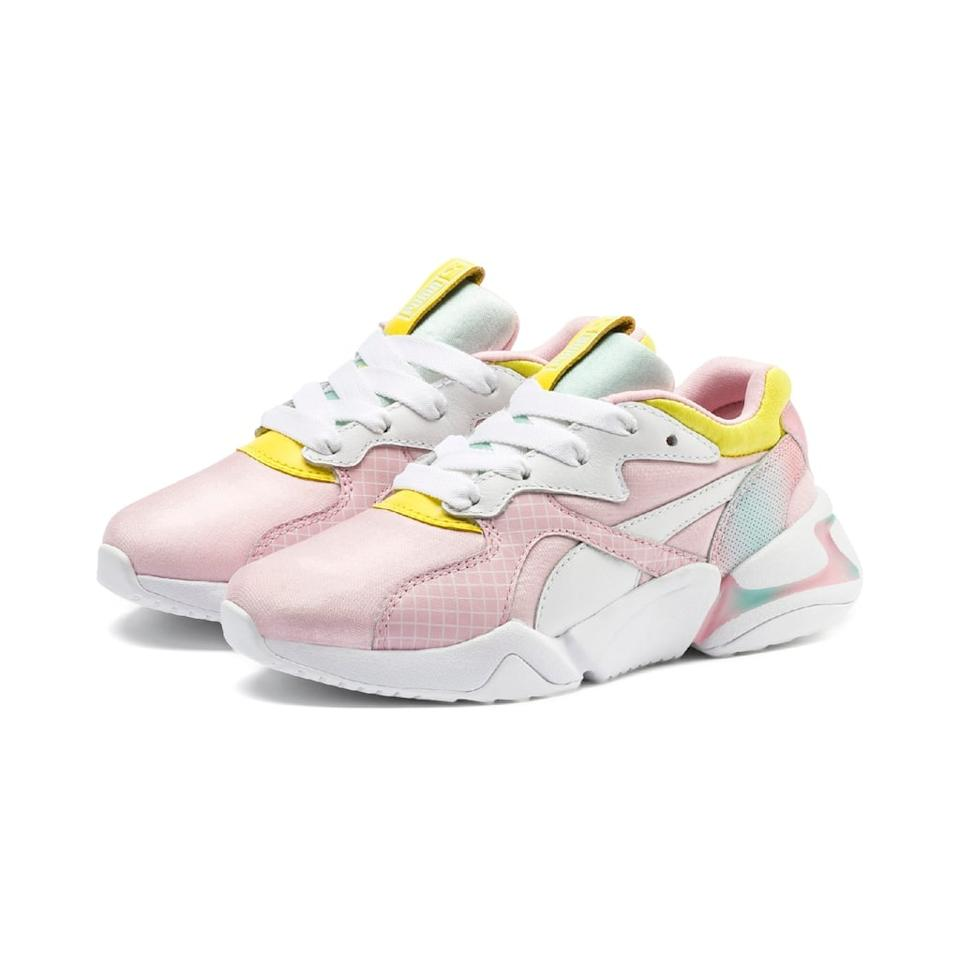 """<p><a href=""""https://www.popsugar.com/buy/Puma-x-Barbie-Nova-Sneaker-498666?p_name=Puma%20x%20Barbie%20Nova%20Sneaker&retailer=bloomingdales.com&pid=498666&price=100&evar1=fab%3Aus&evar9=46691499&evar98=https%3A%2F%2Fwww.popsugar.com%2Ffashion%2Fphoto-gallery%2F46691499%2Fimage%2F46723460%2FPuma-x-Barbie-Nova-Sneaker&list1=shoes%2Csneakers%2Ccollections%2Cdesigner%20collaborations&prop13=api&pdata=1"""" rel=""""nofollow"""" data-shoppable-link=""""1"""" target=""""_blank"""" class=""""ga-track"""" data-ga-category=""""Related"""" data-ga-label=""""https://www.bloomingdales.com/shop/product/puma-x-nova-x-barbie-womens-mixed-media-pastel-lace-up-sneakers?ID=3340582&amp;CategoryID=16961"""" data-ga-action=""""In-Line Links"""">Puma x Barbie Nova Sneaker</a> ($100)</p>"""