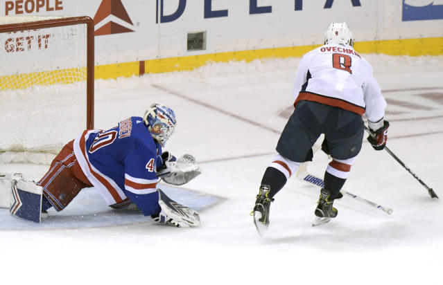 Washington Capitals left wing Alex Ovechkin (8) skates in against New York Rangers goaltender Alexandar Georgiev (40) during a shootout in an NHL hockey game Sunday, March 3, 2019, at Madison Square Garden in New York. The referees ruled that Georgiev threw his stick and awarded Ovechkin the goal. (AP Photo/ Bill Kostroun)
