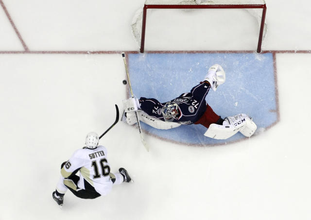 Pittsburgh Penguins' Brandon Sutter, left, scores past Columbus Blue Jackets' Sergei Bobrovsky, of Russia, during the second period of Game 6 of a first-round NHL playoff hockey series Monday, April 28, 2014, in Columbus, Ohio. The Penguins advance to the second round with their 4-3 win over the Blue Jackets. (AP Photo/Jay LaPrete)