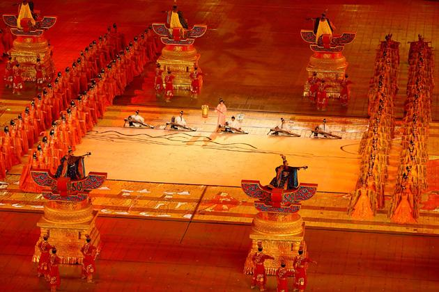 BEIJING - AUGUST 08:  Dancers perform during the Opening Ceremony for the 2008 Beijing Summer Olympics at the National Stadium on August 8, 2008 in Beijing, China.  (Photo by Adam Pretty/Getty Images)