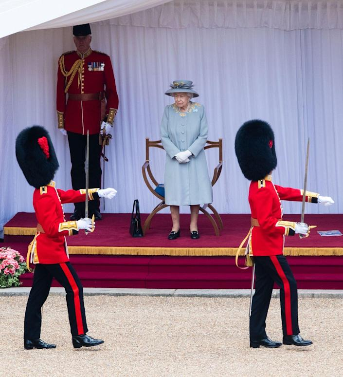 <p>The Queen watching a military ceremony in the Quadrangle of Windsor Castle for Trooping the Colour 2021. </p>