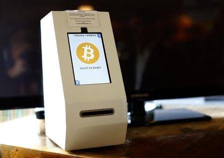 A bitcoin ATM machine is shown at a restaurant in San Diego