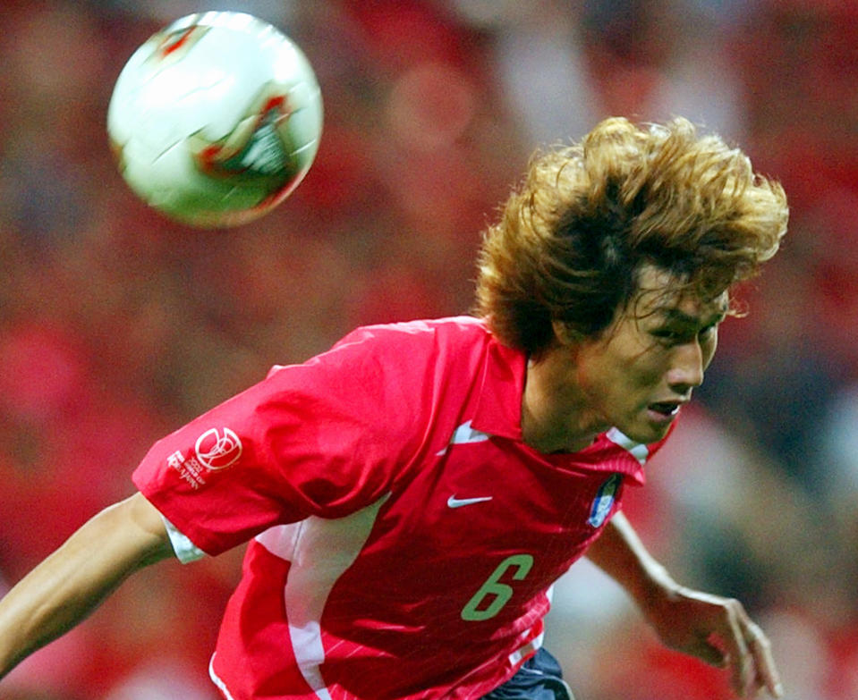 FILE - In this June 25, 2002, file photo, South Korea's Yoo Sang-chul jumps for an header, during the 2002 World Cup semifinal match between Germany and South Korea, at the Seoul World Cup stadium in Seoul, South Korea,. Yoo, one of the stars of South Korea's surprising run to the semifinals at the 2002 World Cup, has died after long battle with pancreatic cancer. He was 49. (AP Photo/Luca Bruno, File)