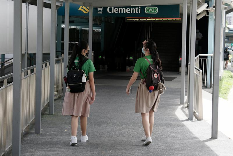 Students in face masks seen in Clementi on 19 June 2020, the first day of Phase 2 of Singapore's re-opening. (PHOTO: Dhany Osman / Yahoo News Singapore)