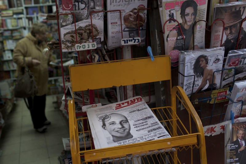 The front page of Israeli newspaper Maariv shows a picture of a man believed to be an Australian-Israeli citizen who mysteriously died in prison after an apparent career in Israel's spy agency, Jerusalem, Thursday, Feb. 14, 2013. The story broke earlier this week when Australian ABC reported that the prisoner, who it referred to as Ben Zygier, migrated from Australia to Israel in 2000 and worked for the Mossad spy agency. It reported that Zygier's incarceration was top secret, but did not say why he had been arrested. It said he was known by at least three different names and had visited countries hostile to Israel. (AP Photo/Bernat Armangue)