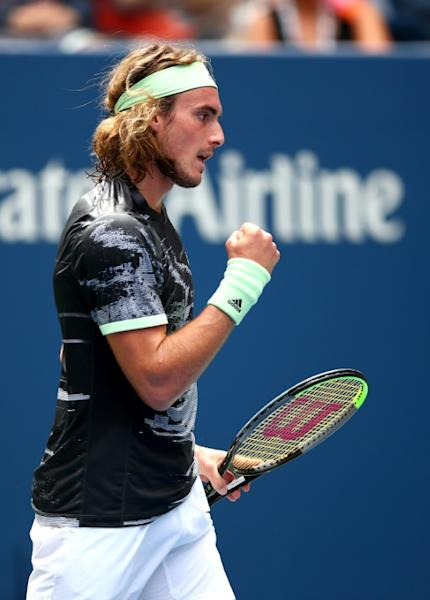 Stefanos Tsitsipas pumps his fist in what would be a four-set loss to Russian Andrey Rublev at the US Open on Tuesday