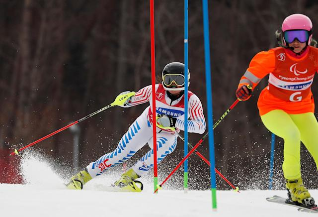 Alpine Skiing - Pyeongchang 2018 Winter Paralympics - Women's Slalom - Visually Impaired - Run 1 - Jeongseon Alpine Centre - Jeongseon, South Korea - March 18, 2018 - Staci Mannella of the U.S. and her guide. REUTERS/Paul Hanna
