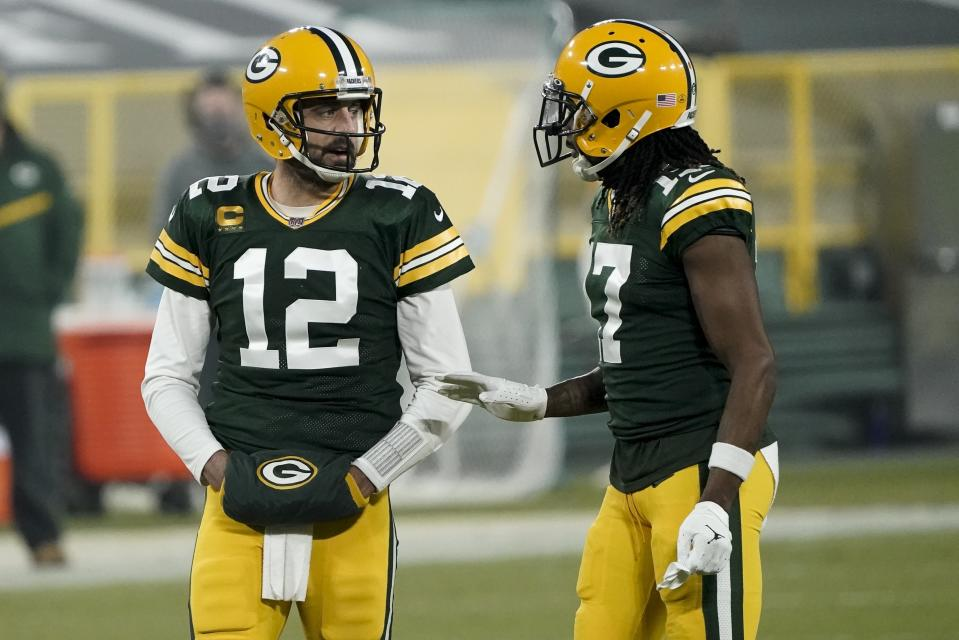Green Bay Packers' Aaron Rodgers talks to Davante Adams