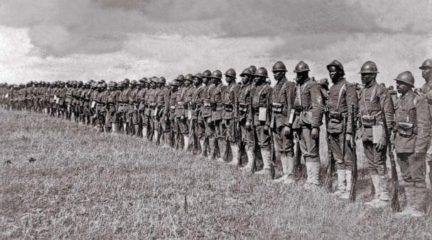 PHOTO: African American soldiers of the 369th Infantry Regiment known as 'Harlem Hellfighters,' line up in France during World War I, ca. 1918. (Everett Collection via Shutterstock  )